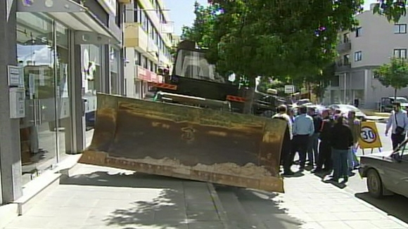 Bulldozer in Front of a Bank in Cyprus Because of Raid on Personal Bank Accounts